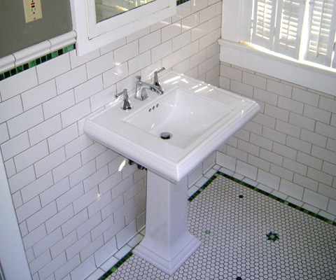 Pedestal sink and glass tile border detail
