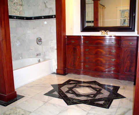 Marble bathroom with antique vanity