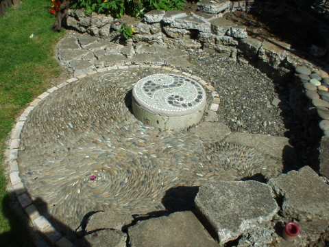 Pebble mosaic patio with fire pit
